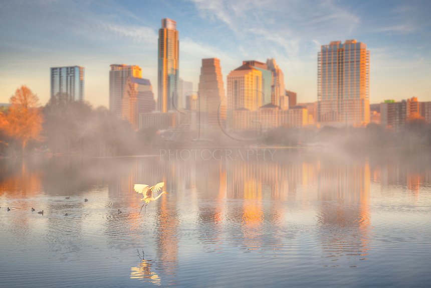 Nature is evident around Lady Bird Lake and Zilker Park as the skyline of downtown Austin, Texas, rises in the cold air of a January morning.