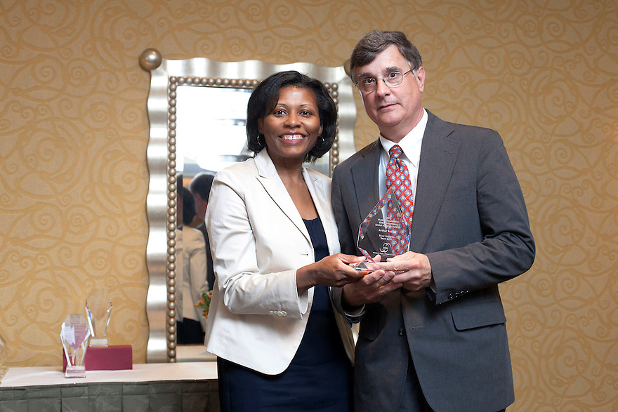 April Hawkins gives Aurthur Budnik his award at the Older Volunteers Enrich America Awards at the Double Tree Hotel in Washington, DC on Friday, June 17, 2011.