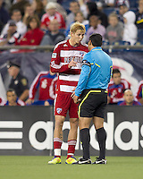 FC Dallas midfielder Brek Shea (20) discusses the yellow card he just received. In a Major League Soccer (MLS) match, the New England Revolution defeated FC Dallas, 2-0, at Gillette Stadium on September 10, 2011.
