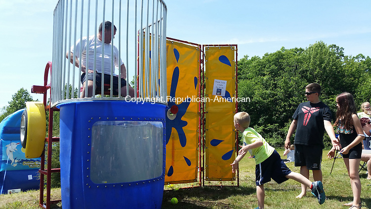 OXFORD, CT- JUNE 07, 2015- 060815_NEW_060715 Oxford Center School Principal Heath Hendershot waits for Aiden Sevick, 7, to send him into the dunk tank at the First Annual Oxford Food and Arts Festival, Sunday.<br /> Nicholas Shigo/Republican American