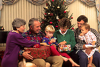 Family opening Christmas presents.