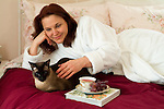 Mature woman lying with her pet