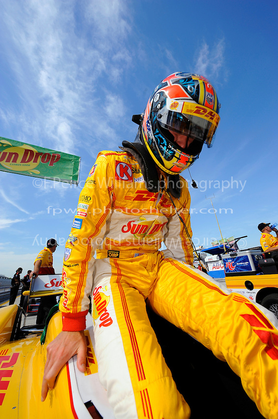 Ryan Hunter-Reay (#28) climbs into his car for qualifying.