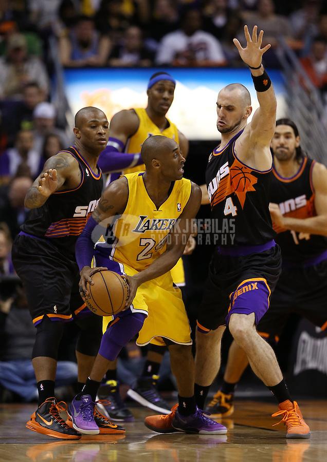 Jan. 30, 2013; Phoenix, AZ, USA: Los Angeles Lakers guard Kobe Bryant (24) drives to the basket against Phoenix Suns center Marcin Gortat (4) at the US Airways Center. Mandatory Credit: Mark J. Rebilas-