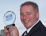 Ally McCoist picks up the manager of the month award after the match