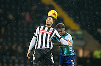 Vadaine Oliver of Notts Co & Anthony Stewart of Wycombe Wanderers during the Sky Bet League 2 match between Notts County and Wycombe Wanderers at Meadow Lane, Nottingham, England on 10 December 2016. Photo by Andy Rowland.
