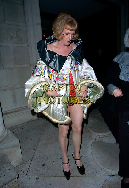 GRAYSON PERRY .The ICA 60: Pecha Kucha gala evening, Royal Institute Of British Architects (RIBA), Portland Place, London, England..May 17th, 2007.full length black white cream cape coat mary janes shoes satin clutch purse cross-dressing gold crotch balls .CAP/CAN.©Can Nguyen/Capital Pictures