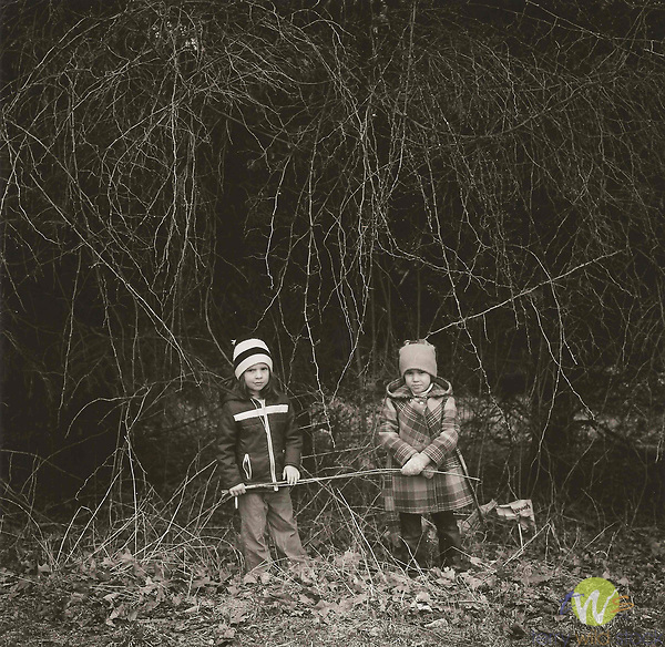 Vintage black and white print scan. Kirsten and friend in the thorns. File #80-149-1.