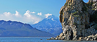A panoramic view of Duck Island in the foreground of an erupting Mount Redoubt, Lake Clark National Park, Alaska.