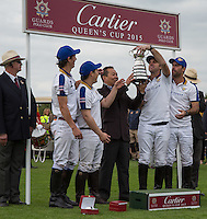 The King Power Foxes team pose with the Cup after winning during the Cartier Queens Cup Final match between King Power Foxes and Dubai Polo Team at the Guards Polo Club, Smith's Lawn, Windsor, England on 14 June 2015. Photo by Andy Rowland.