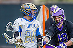 Los Angeles, CA 02/15/14 - Kevin Rowen (UCLA #20) and Kevin Park (Washington #18) in action during the Washington versus UCLA  game as part of the 2014 Pac-12 Shootout at UCLA.  UCLA defeated Washington 13-7.