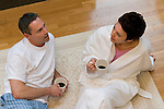 Mature couple drinking coffee and conversing