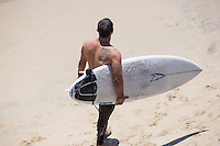 Male Surfer Standing on the Beach in Huntington Beach