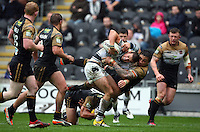 PICTURE BY VAUGHN RIDLEY/SWPIX.COM - Rugby League - Super League - Hull FC v Wigan Warriors - KC Stadium, Hull, England - 22/04/12 - Hull FC's Ben Crooks is tackled by Wigan's Harrison Hansen.