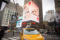An led sign in near Penn Station in New York advertises the European Wax Center chain of hair removal, seen on Sunday, December 21, 2014. (© Richard B. Levine)