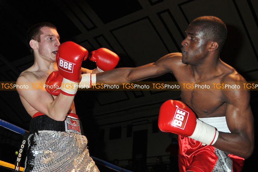 O'Hara Davies (red shorts) defeats Ivans Levikis in a boxing contest at York Hall, London - 19/04/14 - MANDATORY CREDIT: Philip Sharkey/TGSPHOTO - Self billing applies where appropriate - 0845 094 6026 - contact@tgsphoto.co.uk - NO UNPAID USE