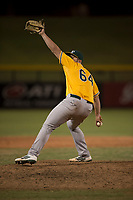 AZL Athletics relief pitcher Dallas Woolfolk (64) delivers a pitch during an Arizona League game against the AZL Cubs 1 at Sloan Park on June 28, 2018 in Mesa, Arizona. The AZL Athletics defeated the AZL Cubs 1 5-4. (Zachary Lucy/Four Seam Images)