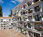 Traditional cemetery decorated with flowers in the Andalucian village of Comares, Malaga province, Spain