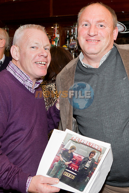 Derek Kelly and Eamon Hanratty, pictured with a photograph of themselves from their time working together, at the Peter Lyons' Bakery Reunion in McHughs..Picture: Shane Maguire / www.newsfile.ie.