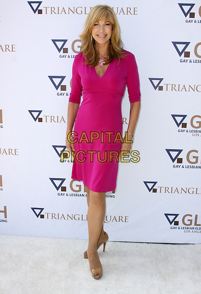LEEZA GIBBONS .8th Annual GLEH Garden Partyheld At A Private Residence, Los Angeles, California, USA, .11th October 2009..full length  pink dress beige peep toe patent platform shoes .CAP/ADM/KB.©Kevan Brooks/AdMedia/Capital Pictures.
