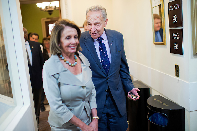 UNITED STATES - OCTOBER 01: House Minority Leader Nancy Pelosi, D-Calif., and Sen. Charles Schumer, D-N.Y., arrive for a news conference in the Capitol's Senate studio on budget negotiations, October 1, 2015. (Photo By Tom Williams/CQ Roll Call)