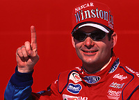 NASCAR driver Jeff Gordon smiles in victory lane at Talladega, AL after winning the Diehard 500 stock car race in April 2000. (Photo by  Brian Cleary)