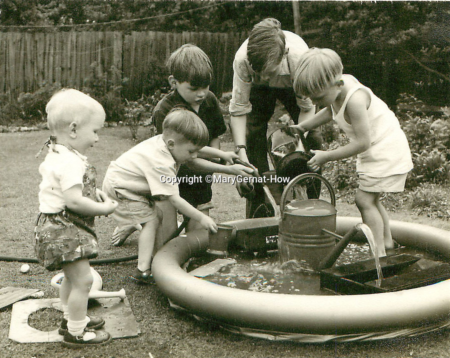 BNPS.co.uk (01202 558833)<br /> Pic: MaryGernat-How/BNPS<br /> <br /> ***Single Use - Not For Archive***<br /> <br /> The boys at play near their seaside home in the early 1960's.<br /> <br /> The real family behind Enid Blyton's iconic book covers has been revealed for the first time thanks to a hidden archive of sketches and family photos.<br /> <br /> Mary Gernat, who created the paperback covers for about 100 children's books in the 1960s, would get her young sons to stop mid-play and pose for her while she quickly sketched ideas for books like The Famous Five, the Secret Series, St Clare's and Malory Towers.<br /> <br /> Her son Roger How, 58, has now unveiled some of his mother's never-seen-before original sketches and finished book drafts which capture the classic images of childhood adventure he and his brothers helped create.