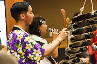 Musicians, and a vocalist, provide music for dancers during a Lunar New Year celebration.