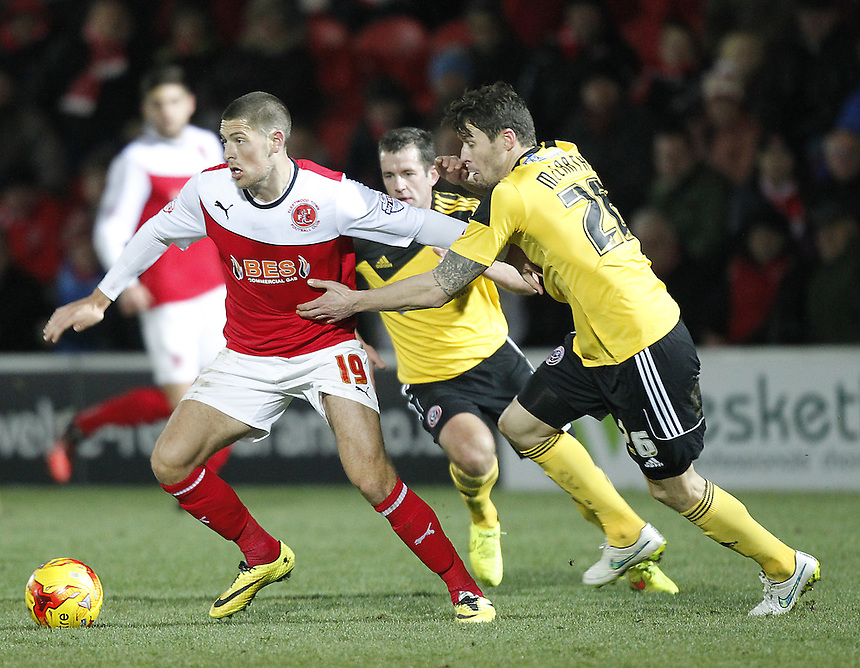 Fleetwood Town's Jamkie Proctor holds off Sheffield United's Paddy McCarthy<br /> <br /> Photographer Mick Walker/CameraSport<br /> <br /> Football - The Football League Sky Bet League One - Fleetwood Town v Sheffield United - Saturday 13th December 2014 - Highbury Stadium - Fleetwood<br /> <br /> &copy; CameraSport - 43 Linden Ave. Countesthorpe. Leicester. England. LE8 5PG - Tel: +44 (0) 116 277 4147 - admin@camerasport.com - www.camerasport.com