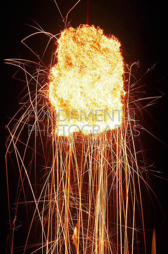STEEL WOOL BURNING IN OXYGEN<br /> Steel Reacts with Oxygen, Giving Off Sparks<br /> Combustion is more rapid in the presence of pure oxygen.