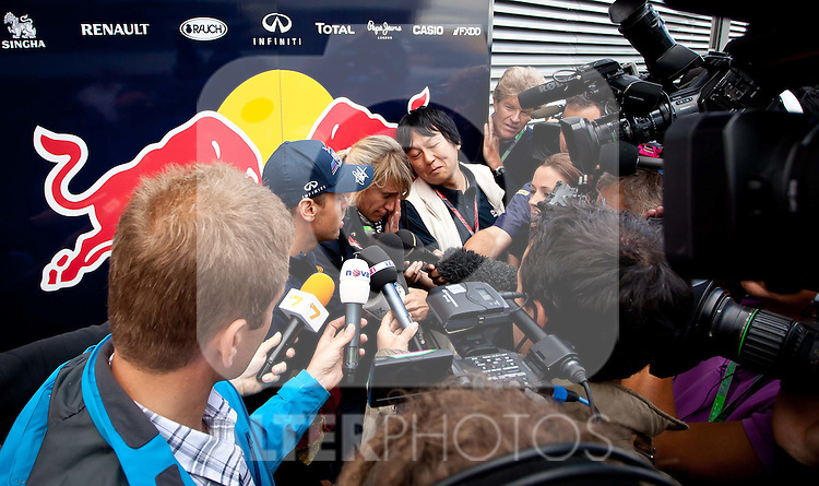 07.07.2011, Silverstone Circuit, Silverstone, GBR, F1, Großer Preis von Großbritannien, Silverstone, im Bild Sebastian Vettel (GER), Red Bull Racing-Renault umringt von Journalisten // during the Formula One Championships 2011 British Grand Prix held at the Silverstone Circuit, Northamptonshire, United Kingdom, 2011-07-07, EXPA Pictures © 2011, PhotoCredit: EXPA/ J. Feichter