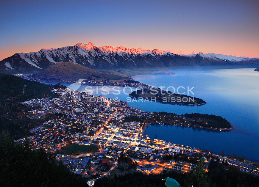 Sunset over the Remarkables and Queenstown from Skyline viewing platform, South Island, New Zealand - stock photo, canvas, fine art print