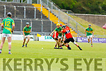 Lixnaw's John Griffin bottled up by Ballyheigues Jason Casey in the Senior Hurling Championship 1st round game in Austin Stack Park on Saturday