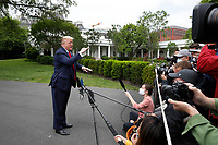United States President Donald J. Trump speaks to the media on the South Lawn of the White House in Washington, DC before his departure to Detroit, Michigan on May 21, 2020. Trump is going to participate in a listening session with African-American leaders and tour Ford Rawsonville Components Plant in Ypsilanti, Michigan. <br /> Credit: Yuri Gripas / Pool via CNP/AdMedia
