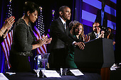 United States President Barack Obama (2nd L) speaks as (L-R) Secretary and Mayor of Baltimore Stephanie Rawlings-Blake, Democratic National Committee Chair and U.S. Representative Debbie Wasserman Schultz (Democrat of Florida), and Vice Chair and President of the Association of State Democratic Chairs Raymond Buckley applaud during the General Session of the 2015 DNC Winter Meeting February 20, 2015 in Washington, DC. President Obama addressed the event and participated in a roundtable discussion. <br /> Credit: Alex Wong / Pool via CNP