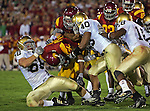Los Angeles, CA 11/25/06 - C.J. Gable is brought down by Notre Dame's Derek Landri (60) and Maurice Crum (40) following a short run up the middle of the Notre Dame defense in the second quarter<br />