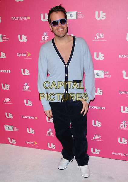 PEREZ HILTON.The Annual US Weekly Hot Hollywood Event held at The Colony in Hollywood, California, USA..November 18th, 2010.full length blue cardigan black jeans denim sunglasses shades.CAP/RKE/DVS.©DVS/RockinExposures/Capital Pictures.