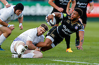 Kyle Eastmond of Bath Rugby looks to offload the ball after being tackled to ground by Jamie Heaslip of Leinster Rugby. European Rugby Champions Cup match, between Bath Rugby and Leinster Rugby on November 21, 2015 at the Recreation Ground in Bath, England. Photo by: Rogan Thomson / JMP for Onside Images