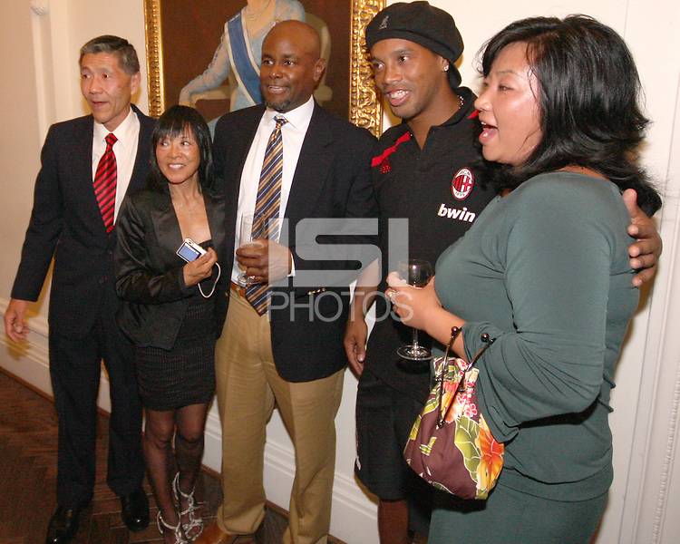 Ronaldinho of AC Milan poses with DC United owner Will Chang and members of his family at a reception for AC Milan at DAR Constitution Hall in Washington DC on May 24 2010.