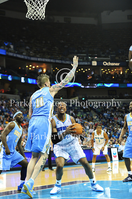 The New Orleans Hornets fall to the Denver Nuggets, 114-103, in NBA action at the New Orleans Arena. Images within this gallery are not available for purchase and appear solely as a representation of my photography.
