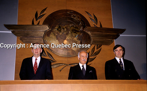 """Montreal (Qc) CANADA - File Photo - Dec 5th 1996 -<br /> Jean Chretien (L), ICAO President (L) and<br /> Lucien Bouchard,  Leader Parti Quebecois (from Jan 29, 1996 to March 2, 2001). seen in a May 1996 file photo at ICAO (OACI) New headquarter opening in Montreal.<br /> <br /> After the Yes side lost the 1995 referendum, Parizeau resigned as Quebec premier. Bouchard resigned his seat in Parliament in 1996, and became the leader of the Parti Qu»b»cois and premier of Quebec.<br /> <br /> On the matter of sovereignty, while in office, he stated that no new referendum would be held, at least for the time being. A main concern of the Bouchard government, considered part of the necessary conditions gagnantes (""""winning conditions"""" for the feasibility of a new referendum on sovereignty), was economic recovery through the achievement of """"zero deficit"""". Long-term Keynesian policies resulting from the """"Quebec model"""", developed by both PQ governments in the past and the previous Liberal government had left a substantial deficit in the provincial budget.<br /> <br /> Bouchard retired from politics in 2001, and was replaced as Quebec premier by Bernard Landry."""