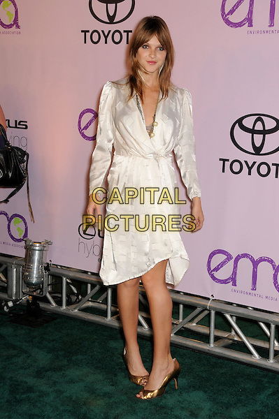 BEAU GARRETT.2009 Environmental Media Awards held at Paramount Studios, Los Angeles, California, USA..October 25th, 2009.full length white cream wrap dress long sleeves gold shoes EMA EMA's EMAS.CAP/ADM/BP.©Byron Purvis/AdMedia/Capital Pictures.
