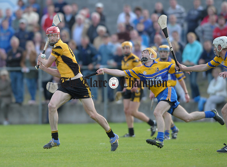 Darach Honan of Clonlara in action against Paul Fitzpatrick of Sixmilebridge during their senior championship game at Clarecastle. Photograph by John Kelly.