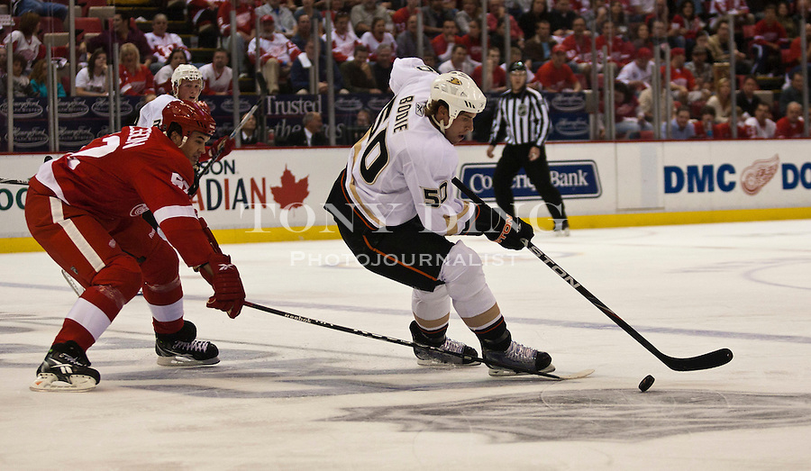 8 October 2010: Detroit Red Wings defenseman Jonathan Ericsson (52) pursues Anaheim Ducks forward Troy Bodie (50) in the first period of the Anaheim Ducks at Detroit Red Wings NHL hockey game, at Joe Louis Arena, in Detroit, MI...***** Editorial Use Only *****