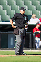 Home plate umpire Tucker Benville stocks up on baseballs between innings of the South Atlantic League game between the Hickory Crawdads and the Kannapolis Intimidators at CMC-Northeast Stadium on April 9, 2014 in Kannapolis, North Carolina.  The Intimidators defeated the Crawdads 1-0.  (Brian Westerholt/Four Seam Images)
