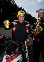 May 19, 2014; Commerce, GA, USA; NHRA pro stock motorcycle rider Eddie Krawiec celebrates after winning the Southern Nationals at Atlanta Dragway. Mandatory Credit: Mark J. Rebilas-USA TODAY Sports