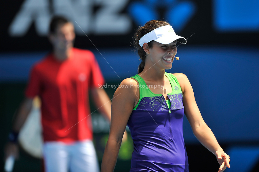 MELBOURNE, 16 JANUARY - Ana Ivanovic enjoys the tennis at the Rally For Relief charity exhibition match by top players of the 2011 Australian Open at Melbourne Park. (Photo Sydney Low / syd-low.com)