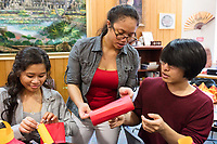 Cynthia Tim, 20, (center) and Socheata Mam, 19, (left) create paper lantern crafts at a Lunar New Year celebration at Middlesex Community College's Asian American Connections Center on Thurs., Feb. 15, 2018. Tim is a Cambodian-American and a second year student at Middlesex Community College studying Business. Mam is a Cambodian-American first year student studying Criminal Justice. The Asian American Connections Center was established at the school using a federal grant in 2016 and serves as a focal point for the Asian community at the school, predominantly Cambodian, to gather, socialize, study, and otherwise take part in student life.