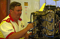 James Chambers prepares the engine for Terry Rinker.