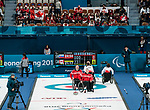 PyeongChang 14/3/2018 - Fans cheer as Canada takes on Slovakia in wheelchair curling at the Gangneung Curling Centre during the 2018 Winter Paralympic Games in Pyeongchang, Korea. Photo: Dave Holland/Canadian Paralympic Committee